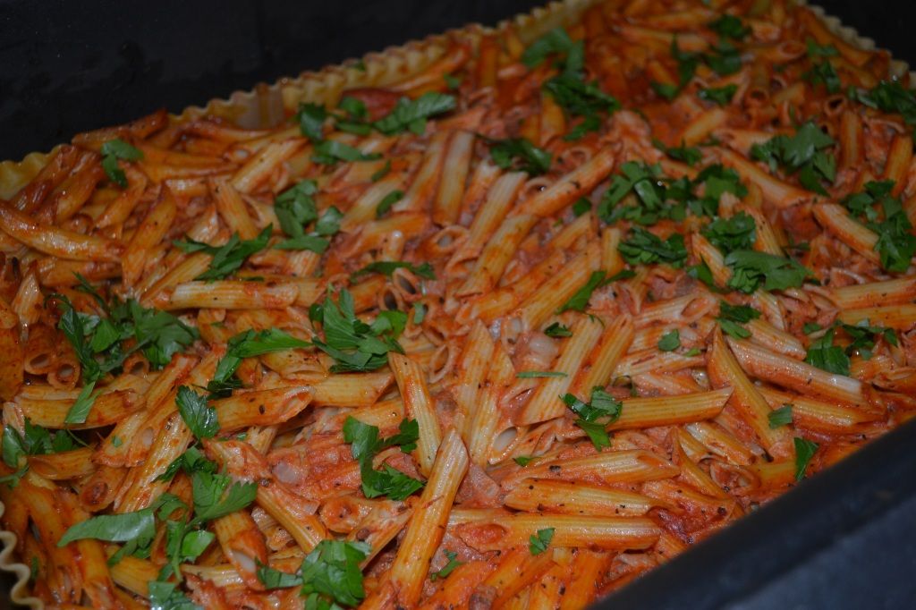 You can see the lasagna noodles lining the edge of the pan. This keeps the pasta from drying out as it cooks!